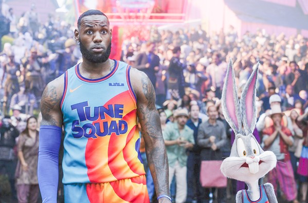 TEAM WORK LeBron James teams with Bugs Bunny and other cartoon characters to win a basketball game and save his son, himself, and his family from being trapped inside a computer network, in Space Jam: A New Legacy, in local theaters and on HBO Max. - PHOTO COURTESY OF WARNER BROS.