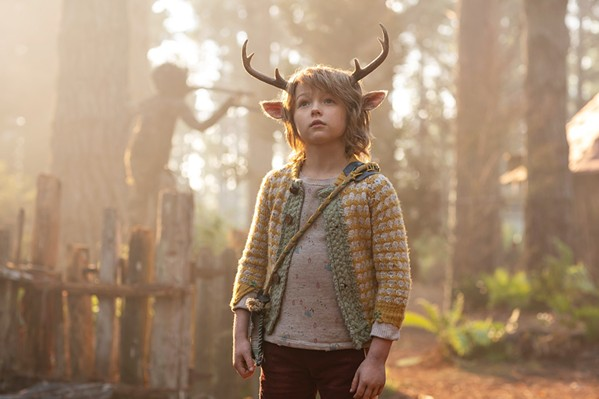 SEARCHING FOR ANSWERS Gus (Christian Convery), a human-deer hybrid, navigates a post-apocalyptic world in search of his origins, in the Netflix TV series Sweet Tooth. - PHOTO COURTESY OF DC ENTERTAINMENT AND NETFLIX