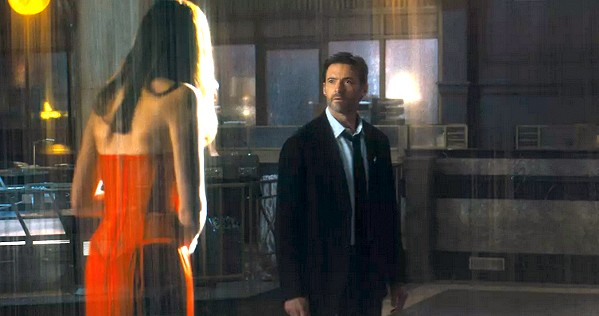 SCI-FI SLEUTH After the woman he loves goes missing, Nick Bannister (Hugh Jackman) begins revisiting his own memories over and over in an attempt to find clues and track her whereabouts, in Reminiscence. - PHOTO COURTESY OF WARNER BROS. PICTURES