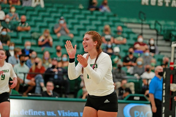 LEADING THE CHARGE Volleyball team co-captain Meredith Phillips led her team to win two of five sets at their first home game in more than 600 days on Sept. 1. - PHOTOS COURTESY OF CAL POLY ATHLETICS COMMUNICATIONS