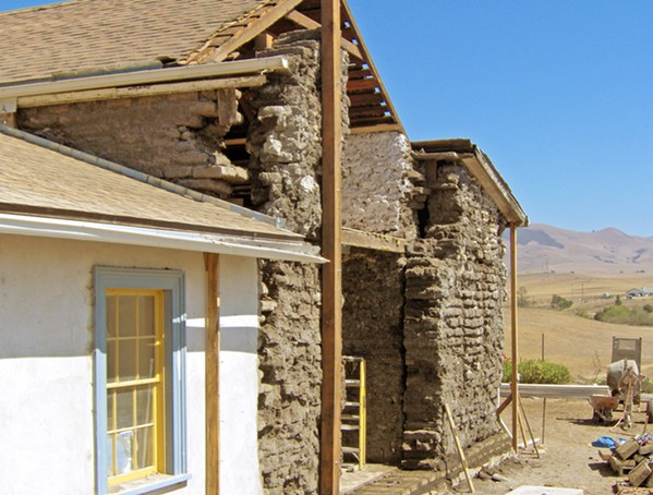 HISTORY RESTORED Here, the Dana Adobe is pictured mid-restoration. The exposed bricks call back to the building's traditional Adobe roots, and the restored parts exhibit some of the Greek revival elements that were woven into the original building. - PHOTO COURTESY OF DANA ADOBE
