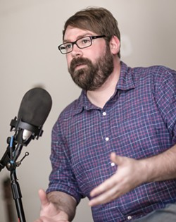HOMEGROWN PODCASTER Central Coast native Chris Lambert discusses his viral podcast Your Own Backyard in his new home studio in Orcutt. - PHOTO BY JAYSON MELLOM
