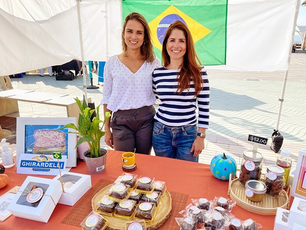 HOOKED ON HONEY Honey Bee SLO co-owners Vanessa Higgins, left, and Carina Lahmeyer sell their homemade Brazilian honey cakes at several Central Coast locations, including Pismo Beach Farmers' Market at the Pier Promenade on Wednesdays from 4 to 7 p.m. until Oct. 27. - PHOTO BY CHERISH WHYTE