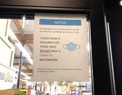 MASK OPTIONAL According to Atascadero resident Colleen Annes, this sign was posted at the city's Food4Less location as recently as Oct. 8. As of Oct. 12, it appeared the grocery store's signage was requiring masks for all, though many customers inside were not wearing them. - PHOTO COURTESY OF COLLEEN ANNES
