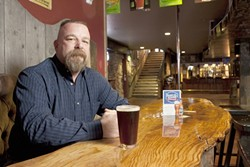 THE WATERING HOLE :  Ron Roberson (pictured) and his wife Shelly own The Boar's Hole, a new pub in Paso, where fun, music, and beer flow freely. - PHOTO BY STEVE E. MILLER