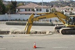 CLOSURE? :  An excavator digs part of a trench near the location where two Teichert Construction employees drowned in 2008 while working on the Nacimiento Pipeline project. The foreman on duty the day they men died was recently sentenced to probation for involuntary manslaughter. - FILE PHOTO BY STEVE E. MILLER