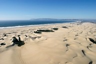 UP IN THE AIR:  Off-road vehicles at Oceano are polluting the air around Nipomo Mesa with sand and dust particles. But what can be done? - PHOTO BY STEVE E. MILLER