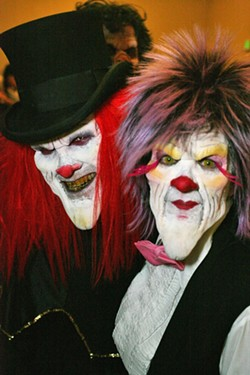 CLOWNING AROUND:  Jeff and Cathy Bague were completely unrecognizable under their evil clown facial prostheses and makeup. - PHOTO BY GLEN STARKEY