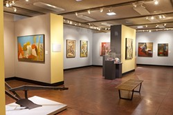 """THE BIG PICTURE :  The current SLOMA exhibit """"A Time and a Place,"""" pictured, uses props such as old farm equipment and '60s furniture to contextualize Peake and Badgley Arnoux's creative encounter. - PHOTOS BY STEVE E. MILLER"""