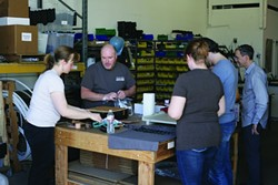 MAKERS:  A group of do-it-yourselfers gathers around a worktable to share their skills. - PHOTO BY GLEN STARKEY