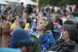 A FACE IN THE CROWD :  The myriad acts on Live Oak's main stage garnered rapt attention from the throngs of concertgoers.