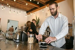 POUR ME ANOTHER:  Spearhead Coffee lead barista Matt Klomp whips up a drink with finesse and deft skill. The Paso Robles specialty coffee house invites the community to celebrate its grand opening this Friday, May 22. - PHOTO BY HAYLEY THOMAS