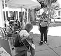 READING, AND SINGING, IN PUBLIC :  James Darden is apprehended by security during his Reading in Public performance on Aug. 1. - PHOTO COURTESY OF NOTHING HAPPENED HERE