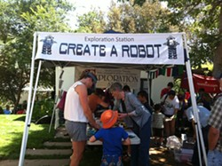 MAKING MOMENTS :  The Mini Maker Faire on May 11 brought robots to life, music to banjos, and families together. - PHOTO BY MAEVA CONSIDINE