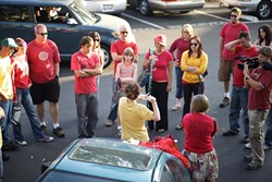T-SHIRT FLASH MOB :  More than two dozen people assembled in the New Times parking lot on Aug. 20 to prepare for a flash mob that involved taking off their shirts at Farmer's Market. - PHOTO BY STEVE E. MILLER