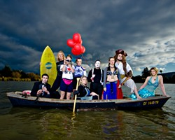 ALL IN THE SAME BOAT :  (l-r) Daniel Salas (musician), Shelley Malcolm (surfer), Sarah Worrell (tourist), Courtney Rucker (cheerleader), Christy Heron ('50s housewife) Amy Asman (mime), Adaire Hahn (belly dancer), Ryan Miller (pirate), and Heather Weltner (mermaid). Art director: Ashley Schwellenbach. Hair and makeup by Shelby Hood. Boat (the Mudhen) courtesy of Glen Starkey. - PHOTO BY STEVE E. MILLER