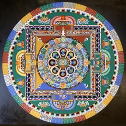COLOR WHEEL:  For each mandala, the monks pour millions of grains of sand into a traditional pattern using a funnel tool called chak-pur. The process can take up to five days to complete. - PHOTO COURTESY OF ANET CARLIN