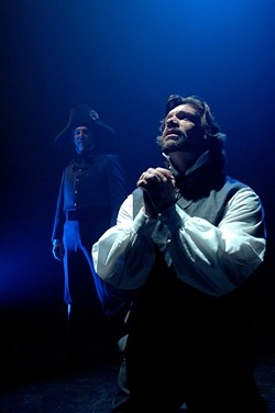 SHADES OF GRAY :  Jean Valjean (Sam Zeller) pursues redemption while shadowed by the immoveable Javert (Erik Stein). - PHOTO BY LUIS ESCOBAR/ REFLECTIONS PHOTOGRAPHY STUDIO