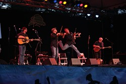 JUMPING FOR JOY! :  Molly's Revenge got the crowd revved up with their high-energy Celtic music.