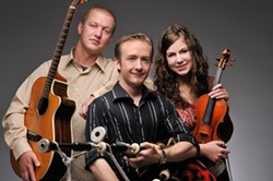 PIPING HOT:   Celtic pipe player David Brewer of Molly's Revenge (center) takes the stage at Painted Sky in Cambria Dec. 23, along with Scottish fiddle champion Rebecca Lomnicky and Irish guitarist George Grasso. - PHOTO COURTESY OF DAVID BREWER