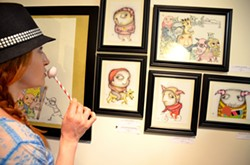 BROWNIE POINTS:  Cat looks into the eyes of artist Bret Brown's madcap creations. - PHOTO BY JESSICA PEÑA