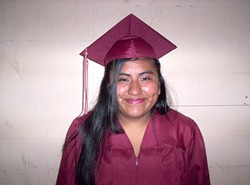 DRESSED FOR SUCCESS :  Teen mom Guadalupe Garcia graduated with honors in June and is now attending Cal Poly. - PHOTO COURTESY OF ECONOMIC OPPORTUNITY COMMISSION