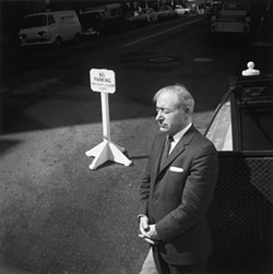 NO PARKING :  Tress captured this image of a San Franciscan enjoying a moment of sunshine, his posture echoed by a nearby sign. - PHOTO BY ARTHUR TRESS