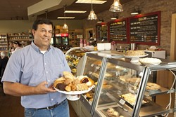 INGREDIENTS FOR SUCCESS :  Cider Creek Bakery co-owner Ken Jevec invites customers in with a pie and a smile. - PHOTO BY STEVE E. MILLER
