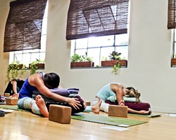 HUSTLE AND FLOW:  The participants of Sun and Moon Flow relax after a tough cycle of yoga with blankets and pillows. - PHOTO BY JESSICA PENA