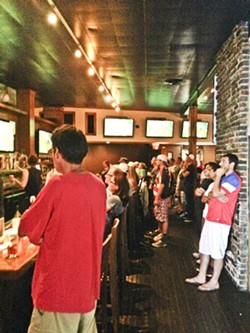 STANDING ROOM ONLY:  Soccer fans packed Tompkins Square Bar & Grill in Los Angeles for the USMNT's match against Portugal on June 22. - PHOTO BY RHYS HEYDEN