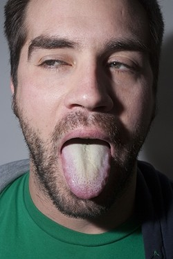 EWW :  Spend a week on the Master Cleanse and you could have a tongue just like this. - PHOTO BY STEVE E. MILLER