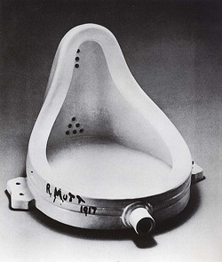 """EARLY FOUND ART :  Marcel Duchamp's """"Fountain"""" is inspiration to Mike, Jordie, and Phoebe's Marxist-Dadaist canine art collective. Perhaps because it's signed """"R. Mutt."""" - PHOTO COUNTESY OF MARCEL DUCHAMP"""