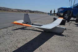 "PUMA POWER:  The Federal Aviation Administration cleared this 13-pound ""Puma"" drone, manufactured by AeroVironment—a California UAV company—for limited commercial use on July 26. - PHOTO BY RHYS HEYDEN"