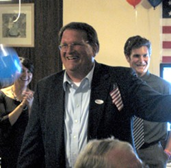 TWIDDLING THUMBS :  Despite holding the lead in the race for District 4 supervisor, Mike Zimmerman and his guests spent most of the night waiting for the election results to update. - PHOTO BY COLIN RIGLEY