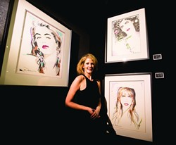 THE MODEL:  Jane Youdelman poses under her portrait (upper right). - PHOTO BY HENRY BRUINGTON