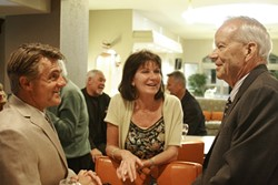 A LOSS AND A WIN :  Council hopeful D.J. White chatted with hotelier Noreen Martin and incumbent councilman Ed Waage at the Hilton Garden Inn. At the time, the election results showed White trailing behind liberal challengers and Waage securing another term. - PHOTO BY NICK POWELL