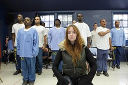 """LONDON SHAKESPEARE WORKOUT:   The inmates of California Men's Colony's West facility performed In a Kingdom of One's Own: An Original Celebration of the Works of William Shakespeare Feb. 20, 21, and 22 under the auspices of the London Shakespeare Workout Prison Project. Pictured are Lucinda Clare and the men's colony performers as they issue a thundering """"Hail Caesar.""""  - PHOTO BY STEVE E. MILLER"""