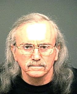 LOCK, STOCK, AND SENTENCED :  Howard Alan Krinsky in a June 2009 booking photo, and the weapons cache confiscated from his Arroyo Grande home. - FILE PHOTO BY COLIN RIGLEY