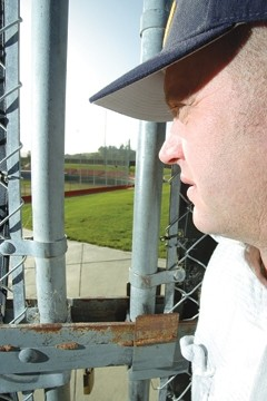 GOLDEN ERA GONE :  Tim Golden looks through the locked gate at Sinsheimer Stadium, where the Blues have played for more than a decade. - PHOTO BY STEVE E MILLER