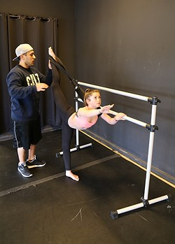 BEHIND THE VIRAL CLIPS:  Teen YouTube dance star Sparkles Lund gets stretched out by her choreographer Marco Cruz at her home studio in Arroyo Grande. - PHOTO BY DYLAN HONEA-BAUMANN