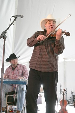 FUNNY BUT GOOD! :  Fiddler Chisholm Wills makes funny faces when he plays, but he's awesome as part of Kenny Kenning's band. - PHOTO BY GLEN STARKEY