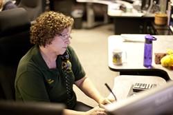 "FIRST LINE :  Dispatchers like Jan Dishen say they're trained to take control of 911 calls because, as she says, ""it's the most traumatic thing that's ever happened in their life, and we're the first person they talk to."" - PHOTO BY STEVE E. MILLER"