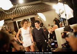 MAN OF THE HOUR! :  Designer Francisco Castro and one of the models soak in the accolades after last Friday's show. May 21 will feature the collections of designer Kristina Michelle. - PHOTO BY STEVE E. MILLER