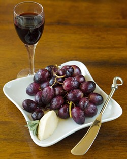 MANNA :  Though Kari Ziegler has no plans to expand to a full restaurant, dishes she offers—like honey-roasted grapes—make a quick and appetizing meal. - PHOTO BY STEVE E. MILLER