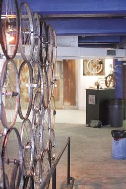 BIKELAND :  The gallery space on Osos Street is an intriguing meld of bikes, art, and fun. - PHOTO BY STEVE E. MILLER
