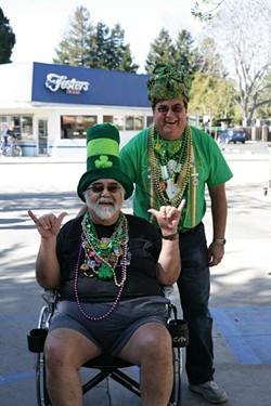 FRIENDS IN NEED:  John Parker wheels his friend Joe Halpen into McCarthy's around 11 a.m. on Monday, March 17. - PHOTO BY GLEN STARKEY