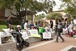 SHARED EMNITY :  San Luis Obispo City Councilman Dan Carpenter greeted a group of protestors in front of City Hall on June 10. The crowd gathered to oppose the city's reinstatement of embattled firefighter John Ryan Mason. - PHOTO BY STEVE E. MILLER