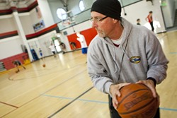 STILL COACHIN' :  In addition to teaching special education courses, Paul Bodenshot serves as the athletic director for George Flamson and Daniel Lewis middle schools in Paso Robles and coaches the Lewis Leopards eighth grade boys' basketball team. Those extra duties once came with a stipend, but after budget cuts and the loss of a grant, he does all the athletics work for free. - PHOTOS BY STEVE E. MILLER