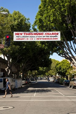 FLYING HIGH :  If you're driving down Higuera Street and can't remember what you're supposed to be doing this week, look up! - PHOTO BY STEVE E. MILLER
