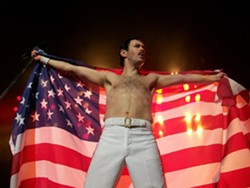 HE WILL ROCK YOU! :  Gary Mullen takes on the role of Freddie Mercury in the Queen tribute show, One Night of Queen, playing March 13 at the Performing Arts Center's Cohan Center. - PHOTO COURTESY OF ONE NIGHT OF QUEEN